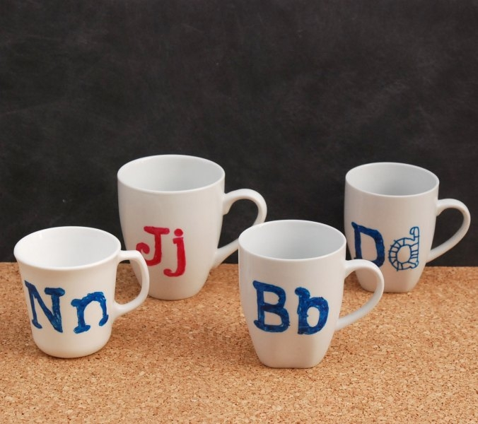 Make these DIY monogram mugs for just pennies! These would be great for Christmas, birthday, or end-of-year teacher gifts