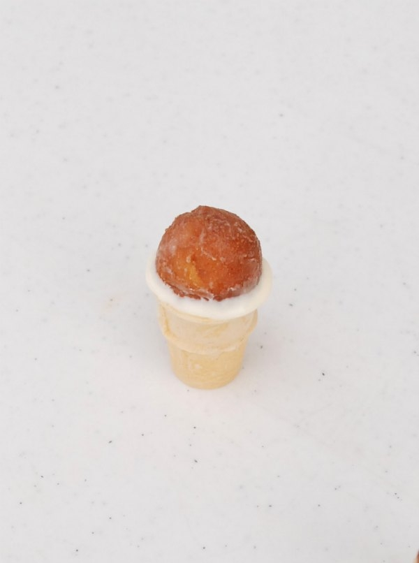 These mini ice cream cone cake pops can be made in minutes using a genius cake pop trick!