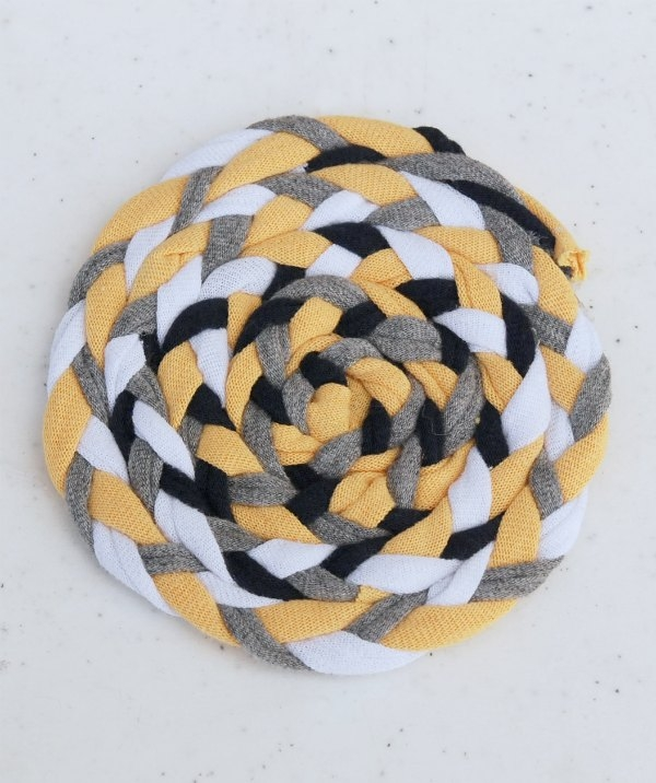 Recycle your old t-shirts into t-shirt yarn and then make sweet, vintage-inspired braided coasters.