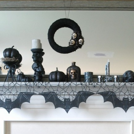 I love this black, silver and white Halloween mantel. It's cute, spooky, and full of easy and inexpensive DIY projects!