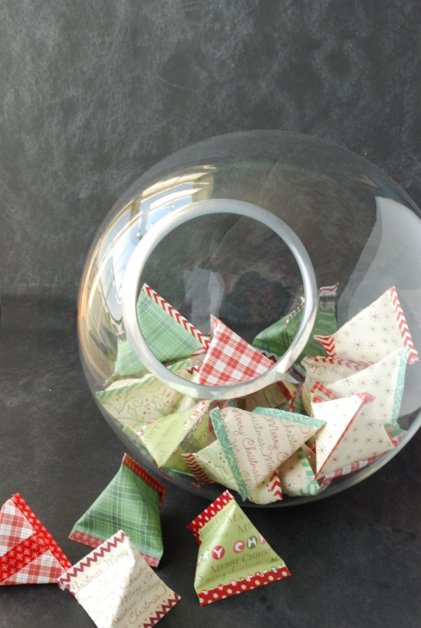 Make a unique advent calendar out of paper pyramid pouches in a bowl. Fill the pouches with candy, toys, notes -- whatever you want -- and let your kids pick one each day!