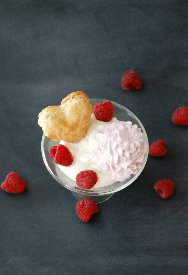 White chocolate mousse sounds kind of intimidating to make, but it's so easy, and is crazy delicious. Top it with some raspberry whipped cream, raspberries and a puff pastry heart for a super special dessert!