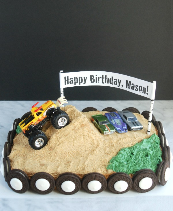 This monster truck birthday cake is so much easier to make than it looks. I love that it's covered with graham cracker crumbs and Oreos, because you don't have to have any frosting skill to make it look great!