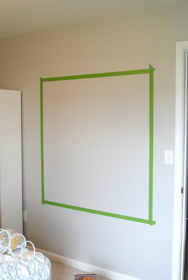 Make a cool wall chalkboard with just some chalkboard paint and some FrogTape. Couldn't be easier!