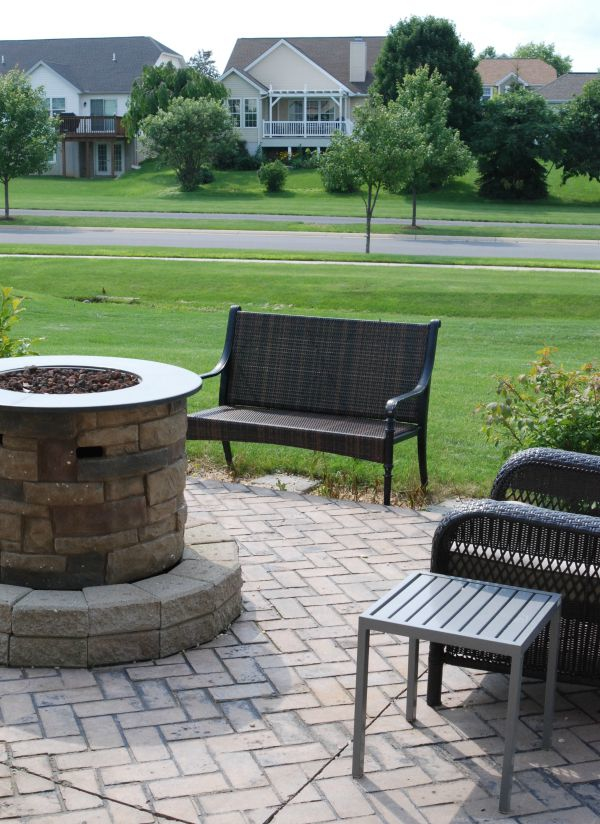 Using just a few purchased items and some objects from around your house, you can perk up your patio for less than $100!