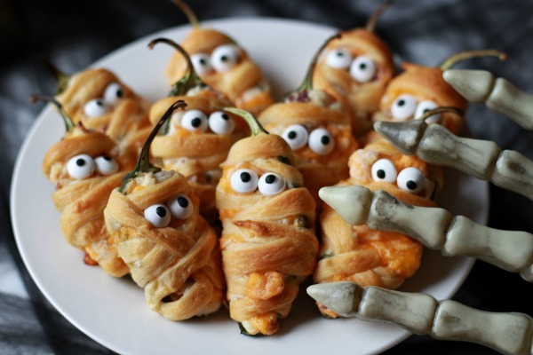 The mummy jalapeno poppers are almost too cute to eat! What a great addition to your Halloween buffet!