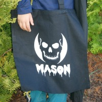 This glow in the dark trick-or-treat bag is so adorable, and so easy to make with a cutting machine.