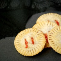 """Strawberry jam oozes from """"bite marks"""" in these fun and easy Vampire Pie Bites!"""