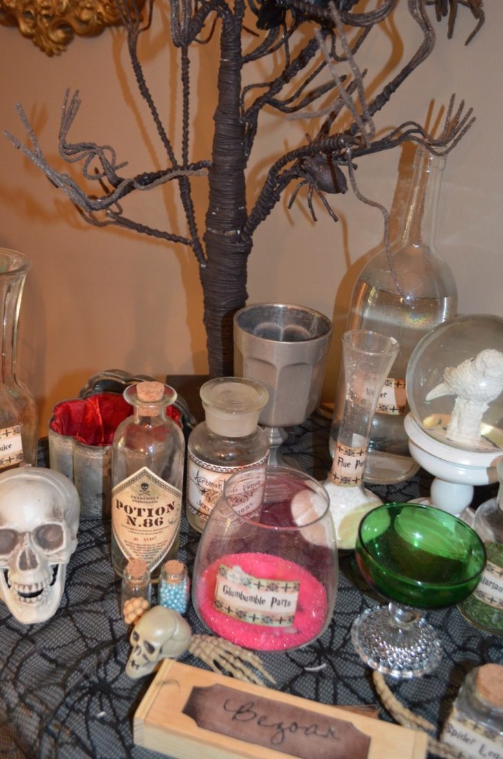 Learn how to set up a spooky wicked with buffet with items from around your house and the thrift shop!